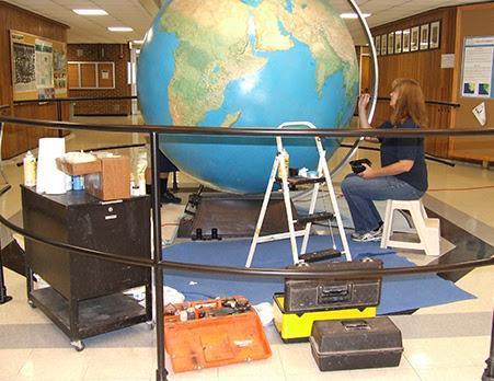 Globe under repair during restoration process