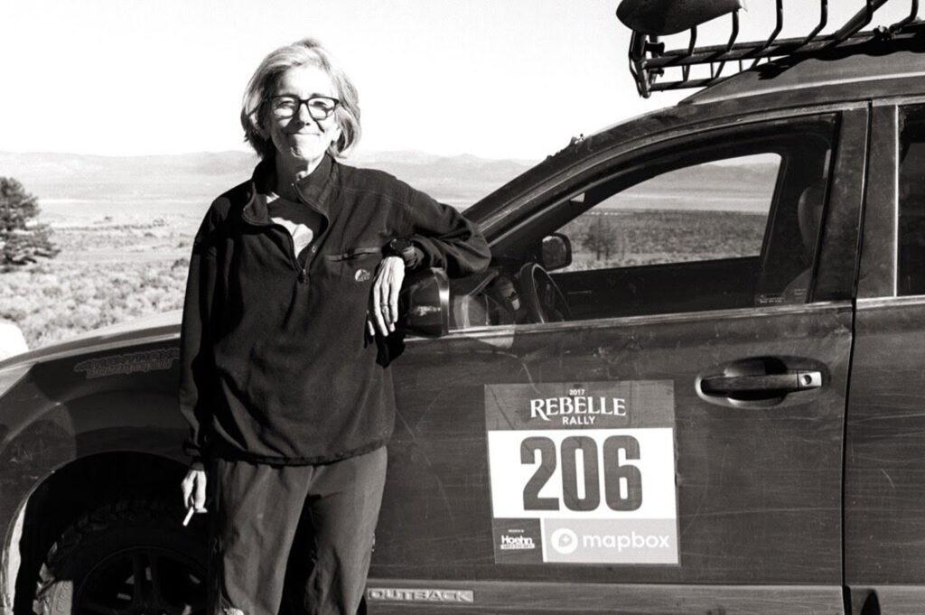 Marty Lawrence takes a break in the desert during an all-women's, off-road navigation rally.