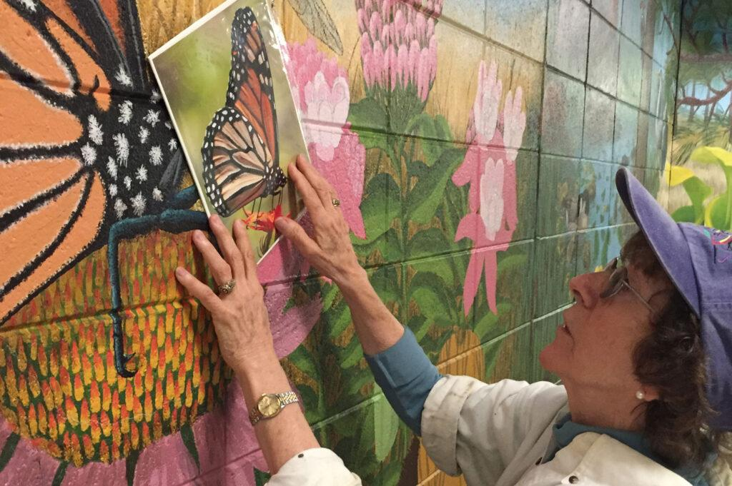 OC Puts Finishing Touch on Mural
