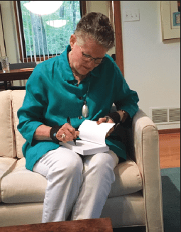 Betty Jean Craige signs one of her books.
