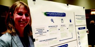 Social Worker Laura Medders with Georgia Memory Net display at GGS conference.